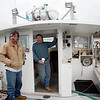 Allegra Boverman/Gloucester Daily Times. Don King, right, and Gil Mitchell, both state permitted fishermen, aboard King's lobster and fishing boat in East Gloucester on Friday.