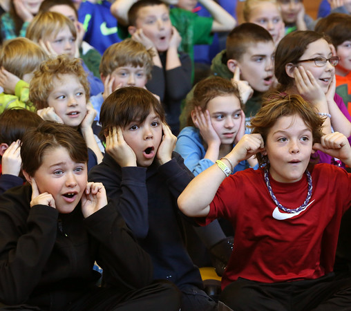 "KEN YUSZKUS/Staff photo.     The 4th and 5th grade students react to a wine glass shattering by the use of sound waves at the Manchester Memorial Elementary School during ""Now Hear This: The Sound of Science"" which was a presentation by the Museum of Science.    3/3/16"