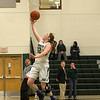 Desi Smith/Staff photo.     Manchester's Melanie Carter (12) is all alone as she lays one up against n South Boston Tuesday night at  Essex Regional High School.  March 1,2016