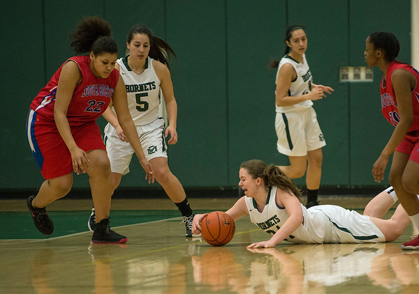 Desi Smith/Staff photo.     Manchester's Sarah Robinson (24) hits the parque floor for a loose ball against n South Boston Tuesday night at  Essex Regional High School.  March 1,2016