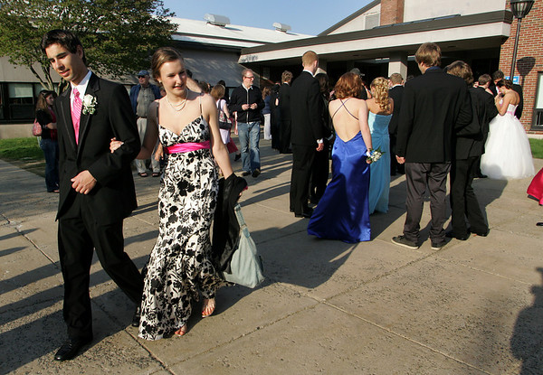 Rockport: Rockport senior Jared Dunn and junior Hannah Evans walk to their ride after leaving the Rockport High School promenade Friday evening.  Juniors and seniors got a chance to show off their fancy attire at the school's gymnasium before heading to their prom at Ipswich Country Club. Mary Muckenhoupt/Gloucester Daily Times