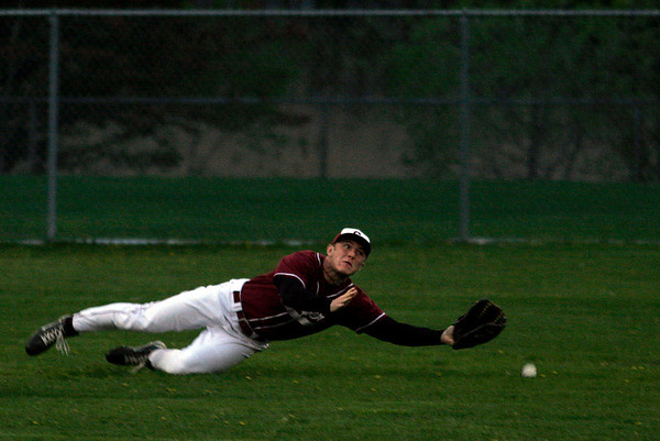 Gloucester: Gloucester's Conor Ressel dives for the ball during their game against Lynn Classical last night. Photo by Kate Glass/Gloucester Daily Times Monday, May 4, 2009