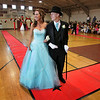 Rockport: Rockport seniors Maggie Donahue and Cameron Frithsen smile  as they pause for photos while walking the red carpet at the Rockport High School promenade Friday evening.  The students got to strut around the school's gymnasium beofore heading off to their prom at Ipswich Country Club. Mary Muckenhoupt/Gloucester Daily Times
