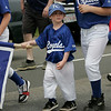 Gloucester: John-John Cusik, 4, walks with the Royals as the team mascot during the Little League parade Saturday afternoon. The parade began at Burnahm's field and ended at Boudreau field with the first game of the season. Mary Muckenhoupt/Gloucester Daily Times Mary Muckenhoupt/Gloucester Daily Times