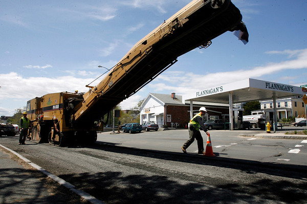 Gloucester: Workers scrape the road surface on Main Street yesterday as they prepare for a repaving project. Photo by Kate Glass/Gloucester Daily Times Monday, May 11, 2009
