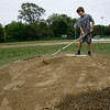 Manchester: Jonathan Browning, 12, rakes the pitchers mound at Sweeney Park yesterday afternoon in preparation for little league games later in the evening. Photo by Kate Glass/Gloucester Daily Times Tuesday, June 9, 2009