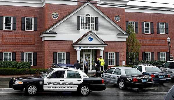 Essex: Police investigate the scene of a robbery at The First National Bank of Ipswich on Martin Street in Essex yesterday afternoon. Photo by Kate Glass/Gloucester Daily Times Tuesday, May 5, 2009