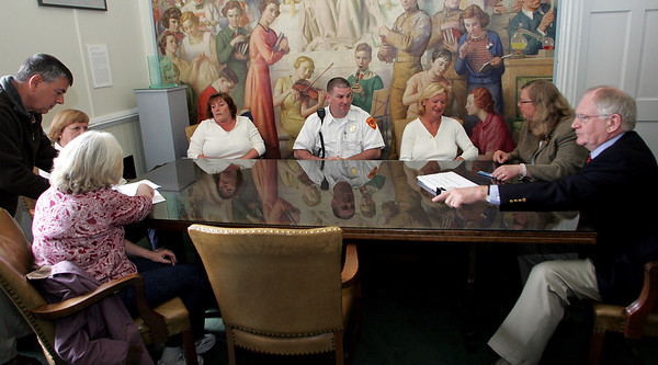 Gloucester: Union leaders met with Mayor Carolyn Kirk in her office Thursday afternoon to sign an agreement to save money on insurance costs. Mary Muckenhoupt?Gloucester Dily Times