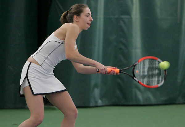 Manchester: Manchester Essex second singles player Annelise Eaton returns a serve during the tennis match against North Reading at the Manchester Athletic Club Wednesday afternoon. Mary Muckenhoupt/Gloucester Daily Times