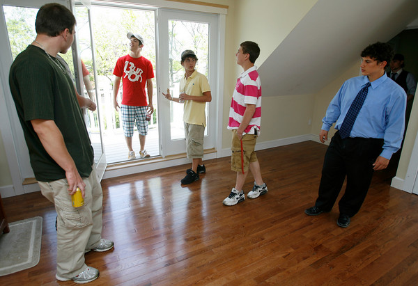 Gloucester: From left: Adam Lovasco, Santo Numerosi, Chris Paul, Brandon Peavey, and Joey Falzarano walk through a Lanesville home they have been working on as part of the Gloucester High School vocational programs during an open house on Thursday. Students have been working on the home for four years and it will be ready for occupants this summer. Photo by Kate Glass/Gloucester Daily Times Friday, May 21, 2009