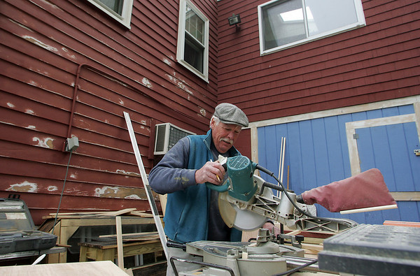 Gloucester: Jon Cranton cuts wood to make shelves for the sales counter at Willow Rest Thursday afternoon. Melissa Donati is reopening Willow Rest after it closed last year and will offer sandwhiches, fresh produce and baked goods. Mary Muckenhoupt/Gloucester Daily Times