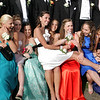 Manchester: Jen Bishop, center, sits on someone's lap as her and her friends squeeze in for a photo at Masconomo Park before heading to prom Friday night.  The junior and senior prom was held at the Hellenic Center in Ipswich. Mary Muckenhoupt/Gloucester Daily Times