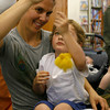 "Essex: Jen Queally shows her son, Jacob Woodman, 3, how to make a sun fairy dance after watching ""The Rain Fairies and The Sun Fairies,"" a puppot show performed by the Waldorf School's Magical Strings Puppet Troupe at the T.O.H.P. Burnham Library on Thursday. Photo by Kate Glass/Gloucester Daily Times Thursday, May 21, 2009"