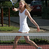 Gloucester: Leila Gaston returns a serve to her Marblehead opponent during the tennis match at Gloucester High School Friday afternoon. Mary Muckenhoupt/Gloucester Daily Times