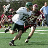 Manchester: Manchester Essex's Tyler wood runs around Newburyport's Gavin Lavalley during the lacrosse game at Ed Field Field Friday afternoon. Newburyport defeated 14-12. Mary Muckenhoupt/Gloucester Daily Times