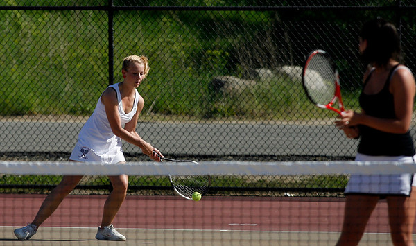 Gloucester: Gloucester's Hannah Benson returns a serve while playing doubles with Lizzie Scatterday against Rockport's Molly Bloomingdale and Nicki AMbrose yesterday afternoon. Photo by Kate Glass/Gloucester Daily Times Thursday, May 21, 2009