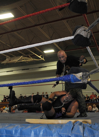 Gloucester: Gloucester police officer Scott (The General) Dufney takes down at the Fuller School Saturday night. Desi Smith Photo/Gloucester Times. May 31,2009
