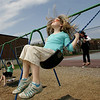 Rockport: Katrina Tuck, 10, enjoys the sunny weather by swinging with her friend Bailey Coates, 10, right, at the playground behind Rockport Elementary School Saturday afternoon. Mary Muckenhoupt/Gloucester Daily Times