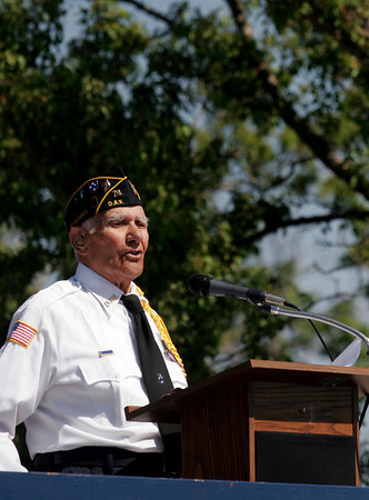Gloucester: Alfred Piscitello, who was a medic during World War II, speaks at the Gloucester Memorial Day ceremony at the Kent Circle World War II memorial yesterday morning. Photo by Kate Glass/Gloucester Daily Times Monday, May 25, 2009