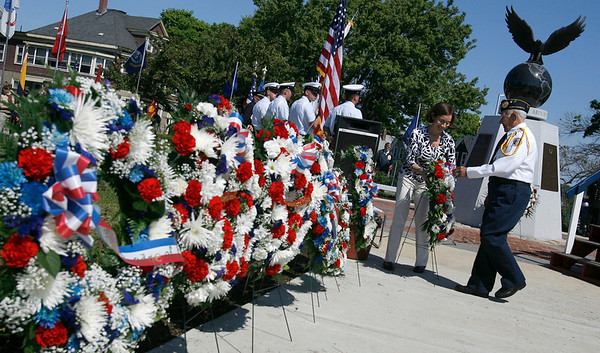 Gloucester: Lucia Amero, left, helps guest speaker Alfred Piscitello place a wreath at the World War II Memorial during Gloucester's Memorial Day ceremony yesterday. Photo by Kate Glass/Gloucester Daily Times Monday, May 25, 2009