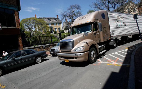 Gloucester: A car had to be towed from a legal parking spot on Main Street so this truck could pass through. Large trucks are not supposed to drive down Main Street, but westbound traffic on Rogers Street was detoured to Main Street, causing confusion. Photo by Kate Glass/Gloucester Daily Times Monday, May 11, 2009