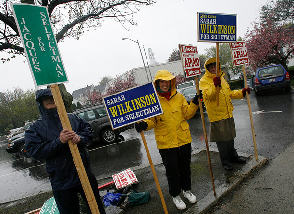 Rockport: Bruce Franklin, left, Barbara Sparks, center, and John Sparks, right, stood in the pouring rain outside Granite Savings Bank to support their candidates for selectmen. Photo by Kate Glass/Gloucester Daily Times Tuesday, May 5, 2009