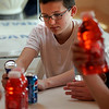 Manchester: Caleb Churchill, a seventh grade student at O'Maley Middle School, looks at the nutrition information on a can of Red Bull during the nutrition segment of the Manchester Athletic Club's Enrichment Program on Wednesday. The students learned about the harmful effects of artificial sweeteners and colors in sports drinks in addition to taking tennis and fitness classes. Photo by Kate Glass/Gloucester Daily Times Thursday, May 20, 2009