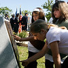 Gloucester: Kaitlin Marques, left, and Shayla Wilson, right, of Girl Scout Troop 149, and friend Charlotte Salmon read one of the plaques at Kent Circle yesterday morning during Gloucester's Memorial Day ceremony. Photo by Kate Glass/Gloucester Daily Times Monday, May 25, 2009