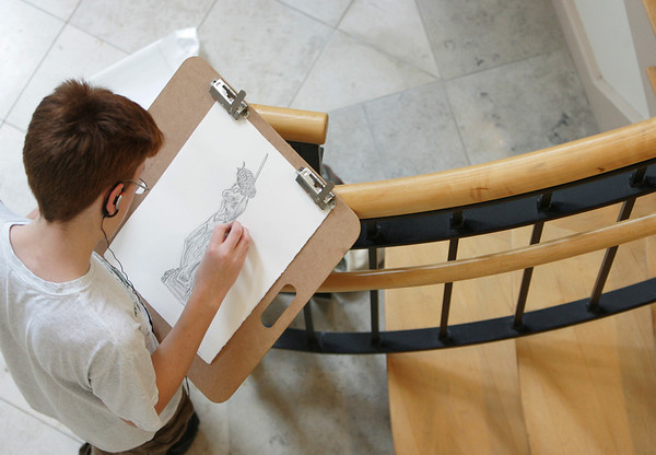 Gloucester: Jeremiah Burke, a nineth grader at Gloucester High School, works on a drawing of a statue by Anthony de Francisci at the Cape Ann Museum Saturday morning. Mary Mukenhoupt/Gloucester Daily Times