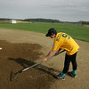 Essex: Cory McCollum, 13, rakes the dirt around second base at memorial Field in Essex Thursday afternoon. Cory and his teammates raked the field before their game to loosen up the dirt that had hardened from all the rain. Mary Muckenhoupt/Gloucester Daily Times
