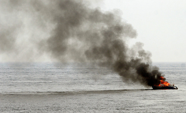 Rockport: A 42-foot trawler caught fire between Thacher Island and Milk Island yesterday afternoon. One man was rescued from the boat, which was traveling from Hingham to Portland. Photo by Kate Glass/Gloucester Daily Times Thursday, May 7, 2009