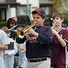 Gloucester:  Robert Strescino, 11, plays the trumpet while walking down Western Boulevard suring the Little League parade Saturday afternoon.  The parade began at Burnahm's field and ended at Boudreau field with the first game of the season. Mary Muckenhoupt/Gloucester Daily Times