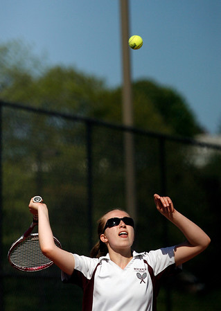 Gloucester: Rockport's Nicki Ambrose tosses the ball on her serve as she plays doubles with partner Molly Bloomingdale against Gloucester's Hannah Benson and Lizzie Scatterday. Photo by Kate Glass/Gloucester Daily Times Thursday, May 21, 2009