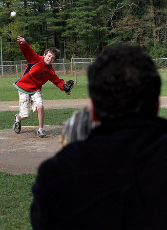 Essex: Eric Fossa, 11, plays catch with his father, Joe Fossa, at the Field of Dreams in Essex on Thursday. Eric is hoping to pitch for his little league team, the Braves. Photo by Kate Glass/Gloucester Daily Times Thursday, May 7, 2009
