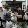 Gloucester: From left, Anna Pereen, letter carrier Dawn Carpenter, Corey Southard, and Ken Morris, help unload bags of food at the Cape Ann Food Pantry Saturday afternoon.  Residents could leave non perishable food items out Saturday for their letter carrier to collect and bring to their local food pantry.  Mary Muckenhoupt/Gloucester Daily Times