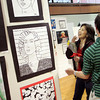 Manchester: Donna Brewster looks at a drawing done by her son Ryan, right, at the Art Gala at Manchester Essex High School Wednesday evening. The gala was a chance for students to dispaly some of their best art work as well as inducting new members into the school's Art Honor Society. Mary Muckenhoupt/Gloucester Daily Times