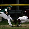 Gloucester: Lynn Classical's Ellido Reyes reaches for the ball as Gloucester's Brett Cahill slides safely into third base last night. Photo by Kate Glass/Gloucester Daily Times Monday, May 4, 2009