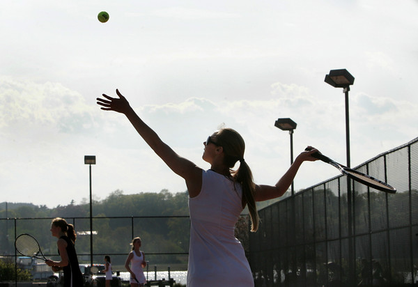 Gloucester: Gloucester first singles player Olivia Lufkin serves to her Marblehead opponent during the tennis match at Gloucester High School Friday afternoon. Mary Muckenhoupt/Gloucester Daily Times
