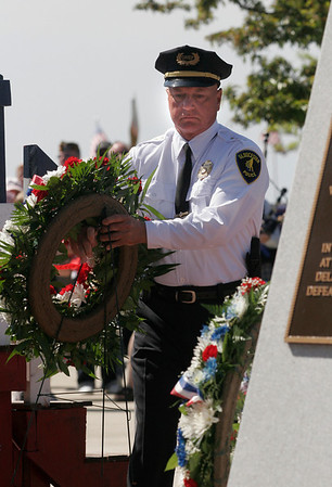 Gloucester: Gloucester Interim Police Chief Michael Lane places a wreath at the World War II memorial during the city's Memorial Day ceremony yesterday morning. Photo by Kate Glass/Gloucester Daily Times Monday, May 25, 2009