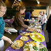 Gloucester: Dianne Quigley, left, and Lori Lukegord, center, both first grade teachers at Plum Cove Elementary School, look over a variety of dishes brought in by 40 parents for a Teachers Appreciation Week luncheon on Wednesday. Hugo Burnham, right, dressed in a morning coat as he waited on the teachers. Photo by Kate Glass/Gloucester Daily Times Wednesday, May 6, 2009