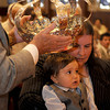 Gloucester: 14 month old Thomas Dort held by his aunt Mary, receives the crowning of the Holy Spirt Sunday morning at Our Lady of Good Voyage Church.Desi Smith Photo/Gloucester Times. May 31,2009