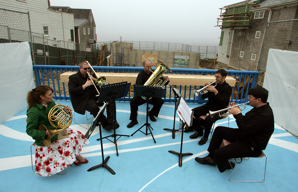 Rockport: The Triton Brass Quintet plays in front of the construction site of the Shalin Liu Performance Center during a ceremony held to mark the completion of the fist phase of construction Saturday afternoon.  Pictured, from left, is Vanessa Gardner playing the Fench horn , Wes Hopper playing the trombone, Jobey Wilson playing the tuba, Andrew Sorg playing the trumpet and Steve Banzaert playing the trumpet. Mary Muckenhoupt/Gloucester Daily Times
