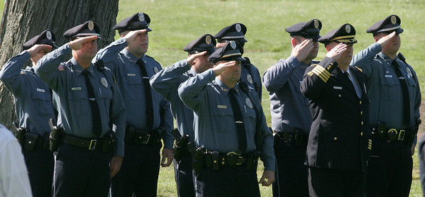 Essex: Essex Police salute as the Middle School Band plays the National Anthem during the town's Memorial Day ceremony at Memorial Park yesterday morning. Photo by Kate Glass/Gloucester Daily Times Monday, May 25, 2009