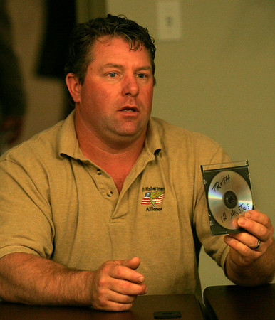 Gloucester: Brian Loftus of Point Judith, R.I. displays a disk of a documentary he made to point out the struggles fishermen face today during the Commercial Fishermen of America meeting at BankGloucester yesterday. Photo by Kate Glass/Gloucester Daily Times Wednesday, May 20, 2009