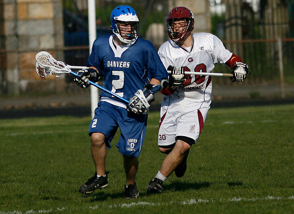 Gloucester: Gloucester's Jeff Lane chases down Danvers' Chris Kontus at Newell Stadium yesterday afternoon. Photo by Kate Glass/Gloucester Daily Times Wednesday, May 20, 2009