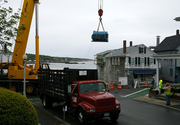 Rockport: Main Street was closed down for most of the day on Wednesday as a crane lifted the boiler and air conditioning units into the basement of the Shalin Liu Performance Center. Contractors hope to have the first floor in place by the time they stop construction for the summer on June 23rd. Photo by Kate Glass/Gloucester Daily Times Thursday, May 27, 2009