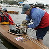 Gloucester: Kim Porter, rowing with husband Bob, puts their dog Padro in the front of their tandem kayak before heading into the river for the Essex River Race Saturday morning. The race is 5.5 mile open water race that was open to all  human powered boats which included kayaks, row boats, dory and seine boats. Mary Muckenhoupt/Gloucester Daily Times