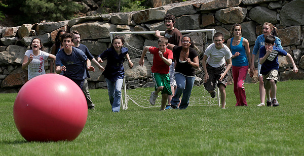 Manchester: O'Maley School seventh graders race to be the first to the ball as they participate in the fitness portion of the Manchester Athletic Club's Enrichment Program. Photo by Kate Glass/Gloucester Daily Times