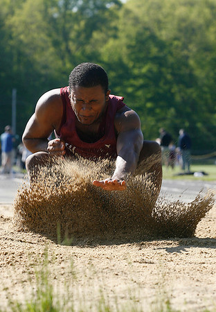 Gloucester: Gloucester's Luis Hernandez braces himself as he lands in the sand pit while competing in the long jump against Danvers yesterday afternoon. The Fishermen tied the Falcons. For more sports coverage, please see page 10. Photo by Kate Glass/Gloucester Daily Times Tuesday, May 19, 2009