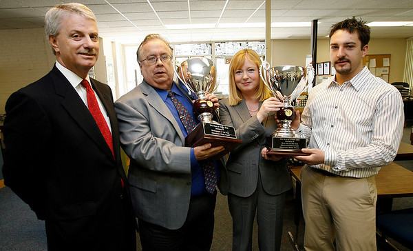 Gloucester: CNHI COO Keith Blevins, Gloucester Daily Times Editor Ray Lamont, CNHI CEO Donna Barrett, and Gloucester Daily Times web coordinator Scott Pytlik display awards for CNHI Newspaper and Website of the Year. Photo by Kate Glass/Gloucester Daily Times Tuesday, May 19, 2009